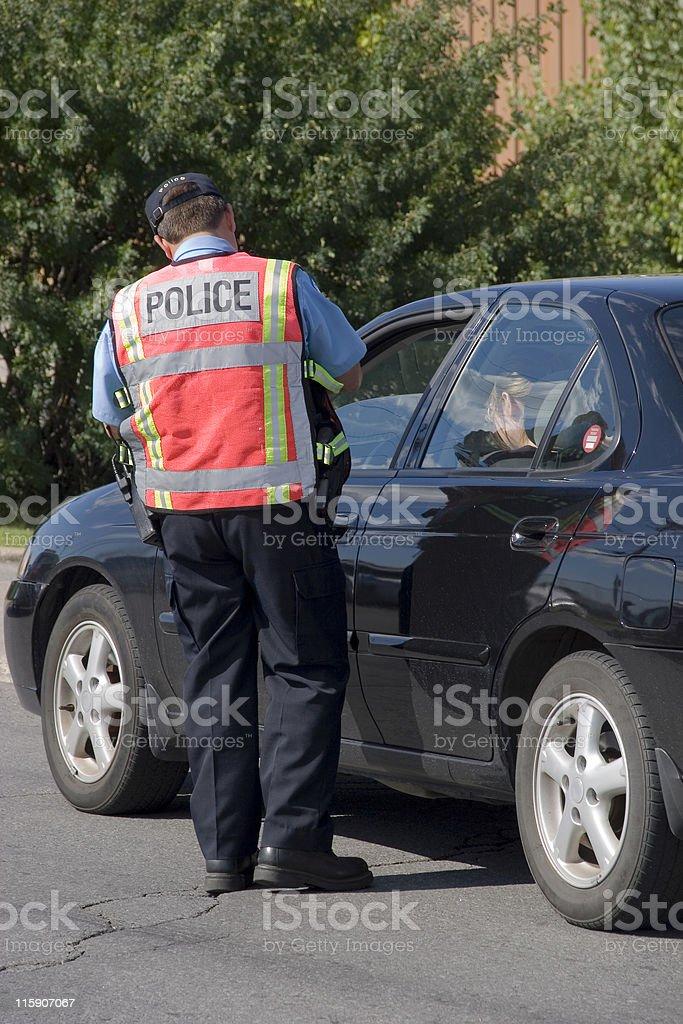 Police writing a speeding ticket stock photo