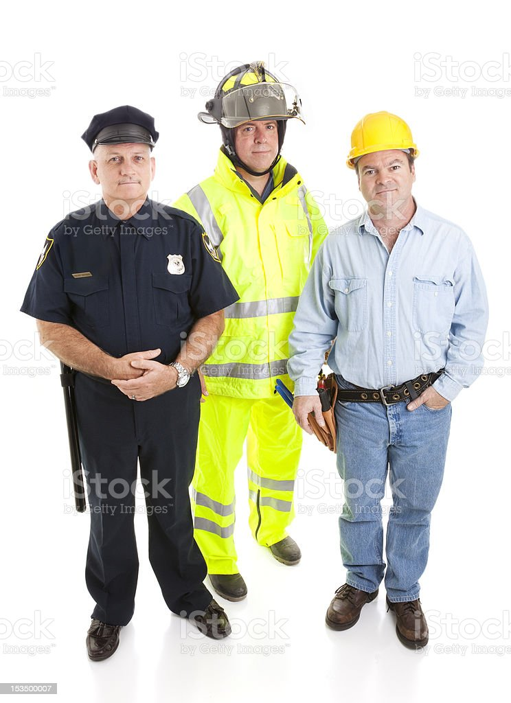 A policeman a fireman and a construction worker stock photo