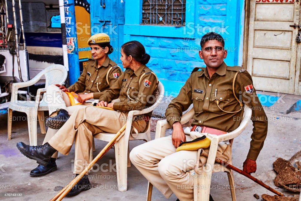 Policeman and Policewomen sitting on Chair in Jodhpur, India stock photo