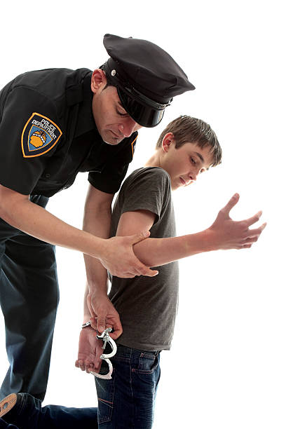 policeman arresting teen criminal - boy handcuffs stock pictures, royalty-free photos & images