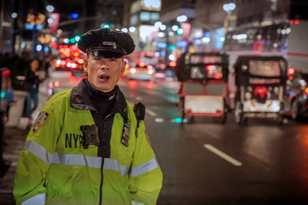 Policeman at 5th Avenue at night stock photo