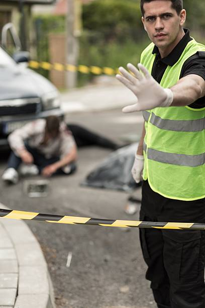 Policeman at car accident area stock photo