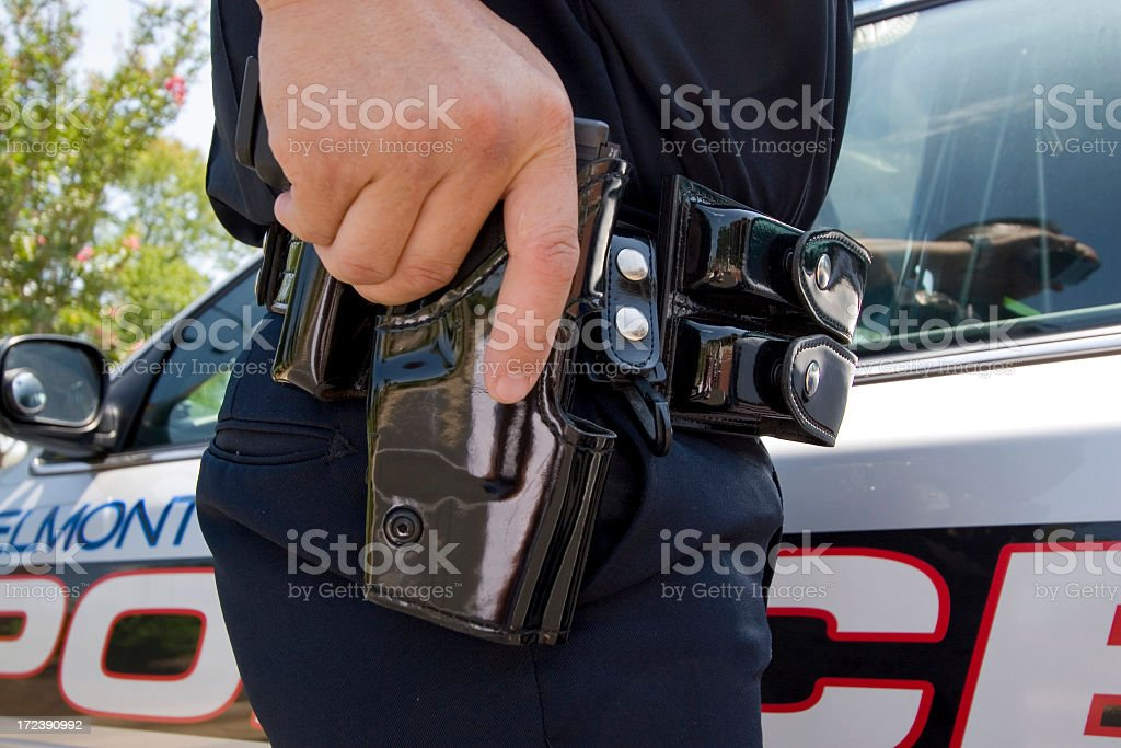 policeman at car with gun royalty-free stock photo