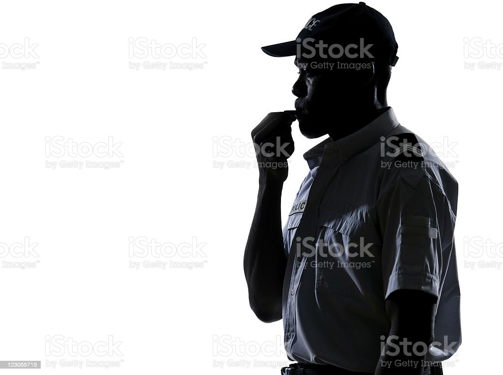 Policeman blowing whistle stock photo