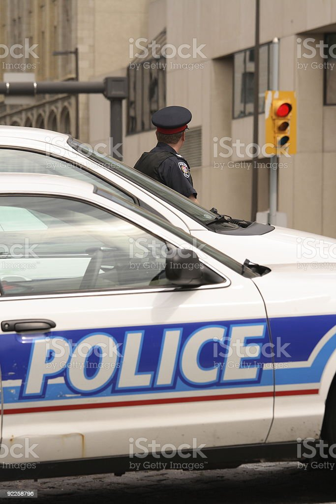 Policeman by Police Cars royalty-free stock photo