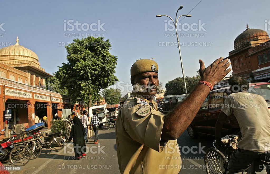 Policeman directs traffic stock photo