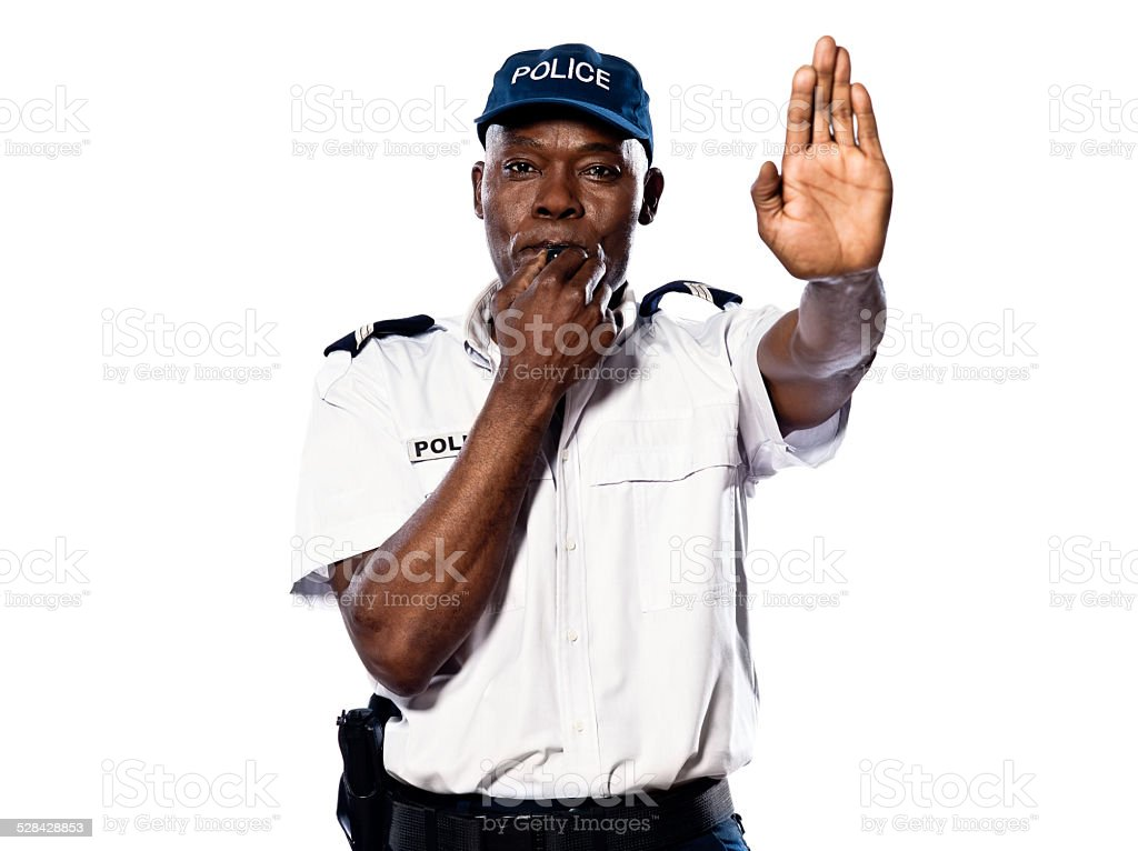 Policeman gesturing to stop and whistling stock photo