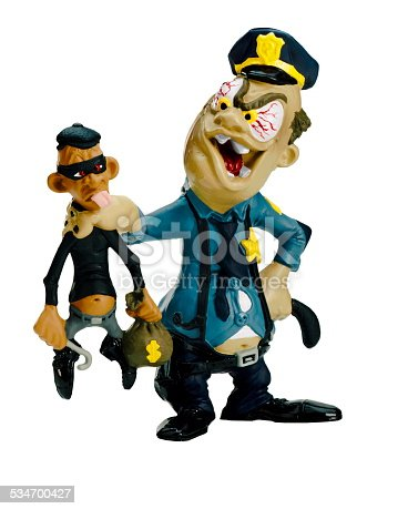istock Policeman Grabbing Thief 534700427