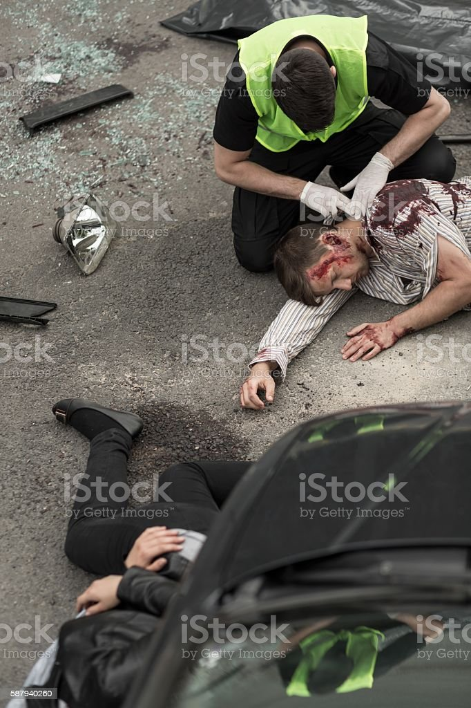 Policeman helping victims stock photo