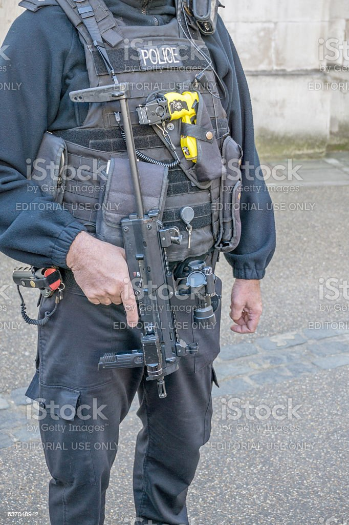 Policeman in uniform with many weapons stock photo