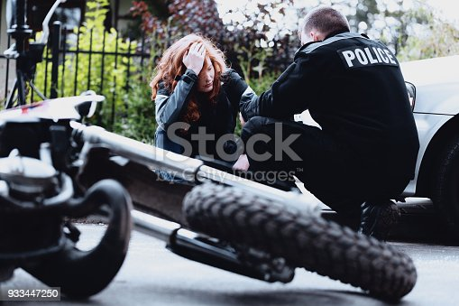 istock Policeman interviewing motorbike driver 933447250