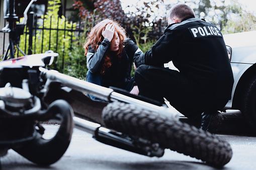 istock Policeman interviewing motorbike driver 933447250