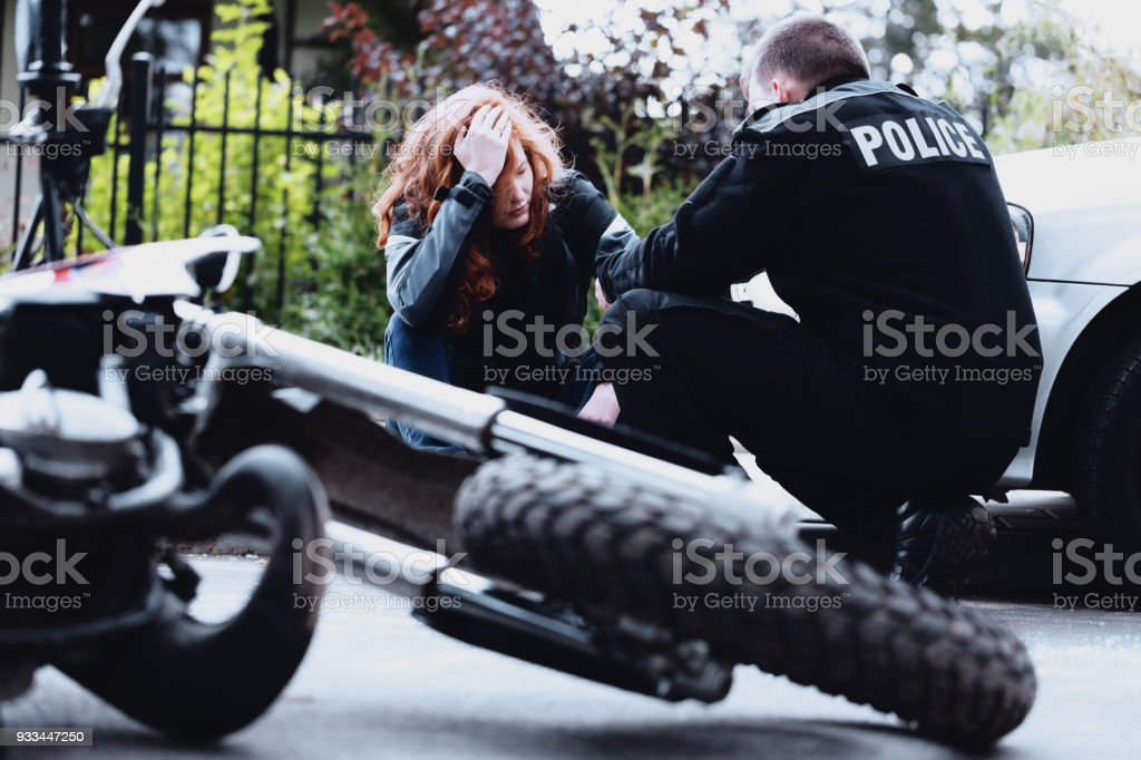 Policeman interviewing motorbike driver stock photo