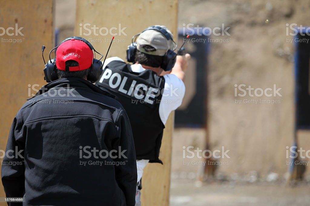 Policeman Officer Shooting 9mm Handgun with Instructor royalty-free stock photo