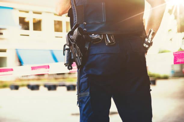 policeman on on a crime scene investigation - polizia foto e immagini stock