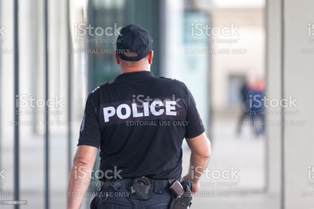 Policeman patrolling in Sofia - Royalty-free Adult Stock Photo