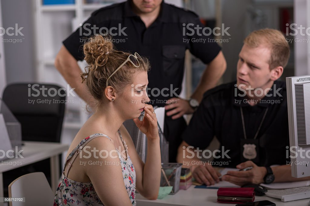 Policeman questioning woman stock photo