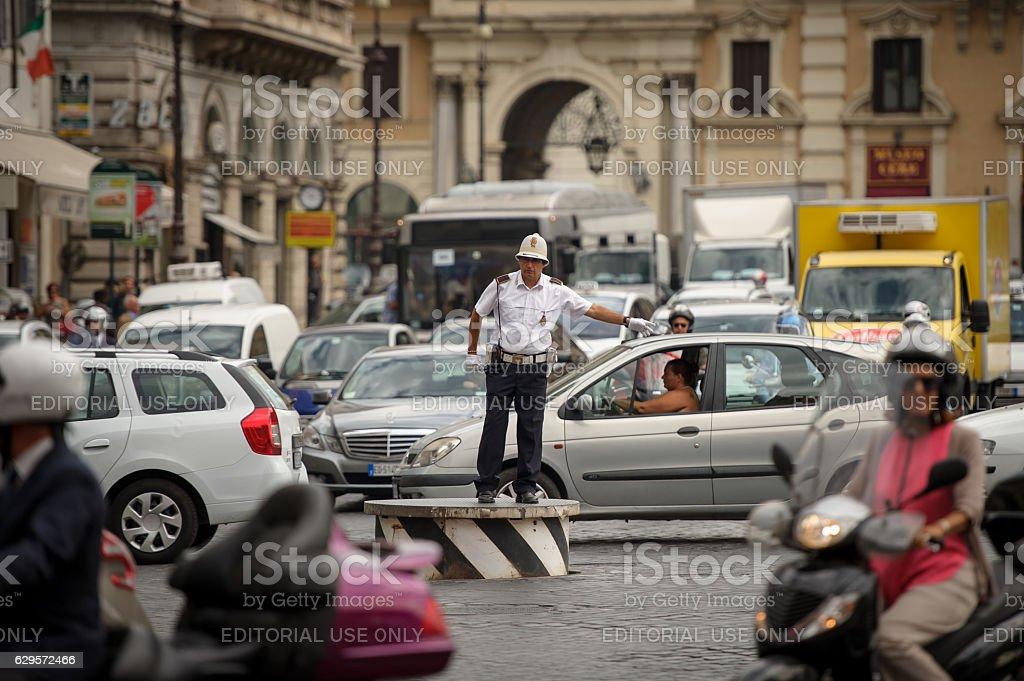 Policeman regulates traffic, Rome stock photo