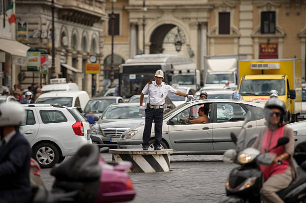 policeman regulates traffic, rome - rond point carrefour photos et images de collection