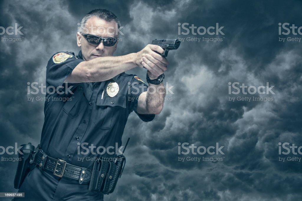 Policeman shooting his pistol stock photo