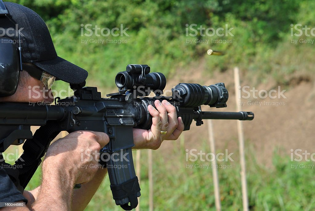 A policeman undertaking rifle training This police SWAT officer practices with his rifle. AR-15 Stock Photo