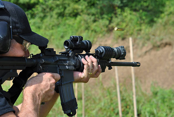 A policeman undertaking rifle training This police SWAT officer practices with his rifle. ar 15 stock pictures, royalty-free photos & images