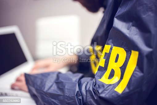 istock Policeman using laptop in office 532253660