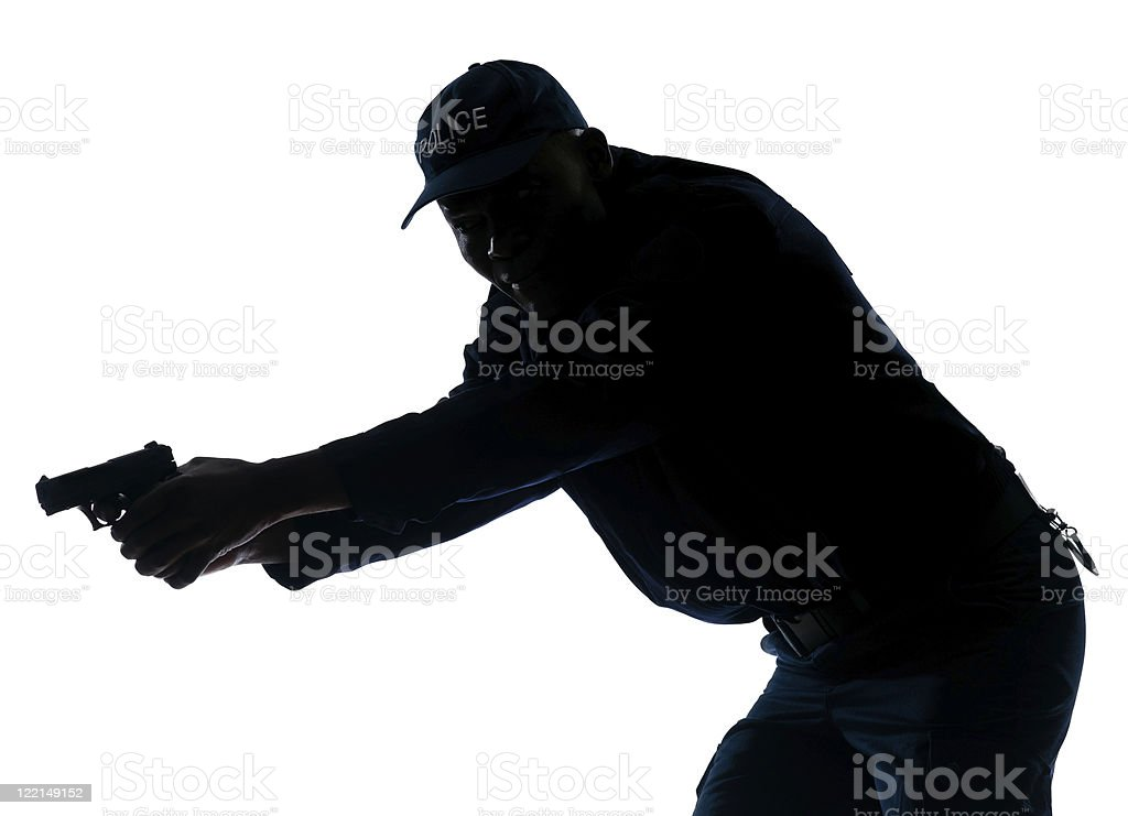Policeman with a handgun royalty-free stock photo