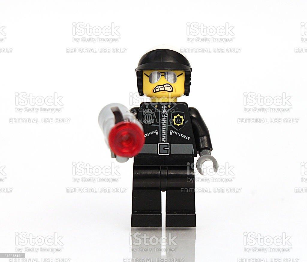 Policeman with gun stock photo