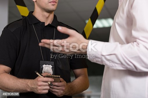 istock Policeman with police badge 492808098