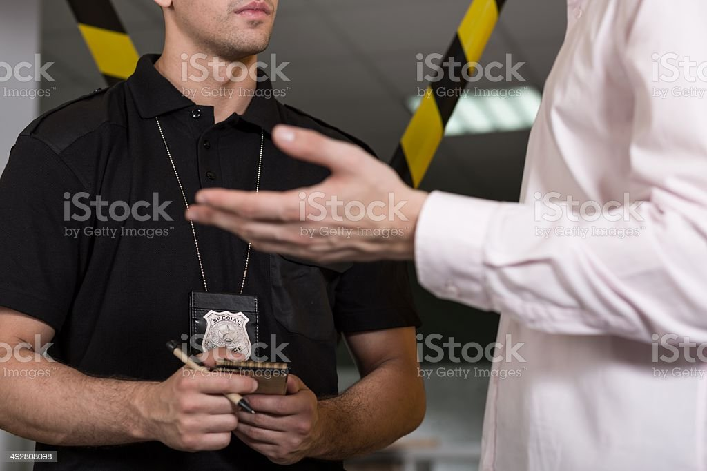 Policeman with police badge stock photo