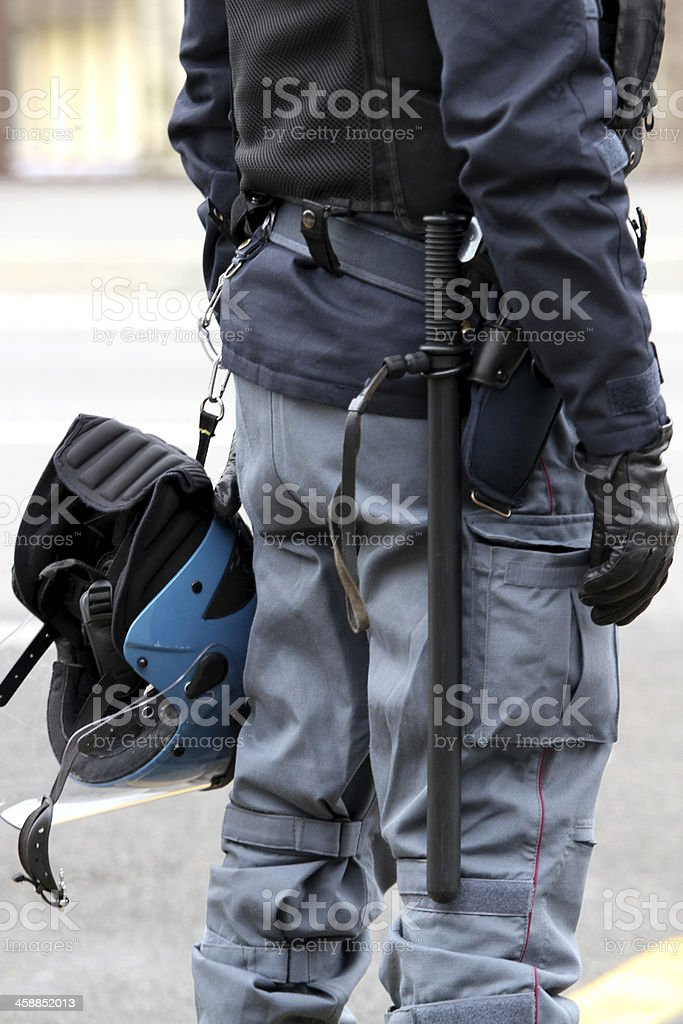 policeman with truncheon, helmet gun and handcuffs royalty-free stock photo