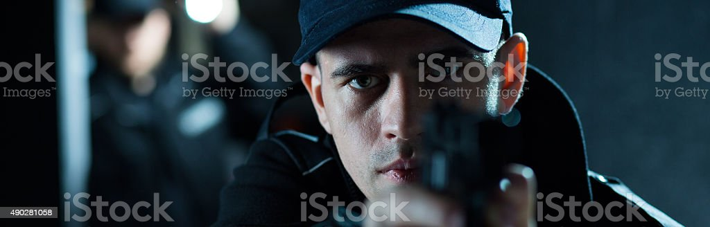 Policeman's frist action stock photo