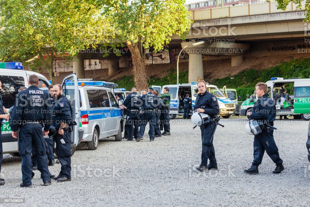 Policemen and policewomen in an action in front of the Cologne exhibition grounds. stock photo