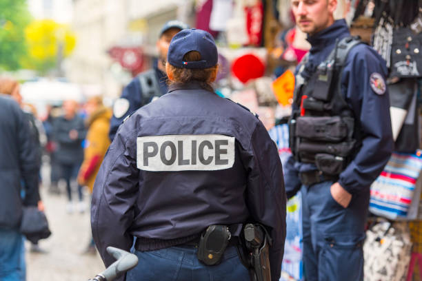 Policemen patrolling at market, Montmartre hill in Paris stock photo