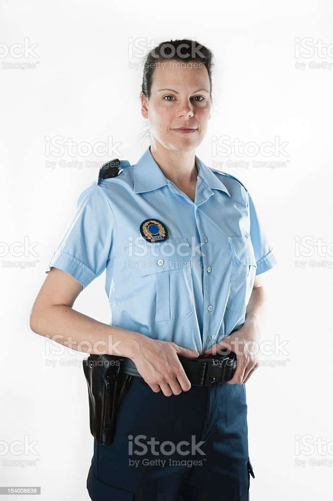 Policewoman in summer shirt on white background, vertical. stock photo