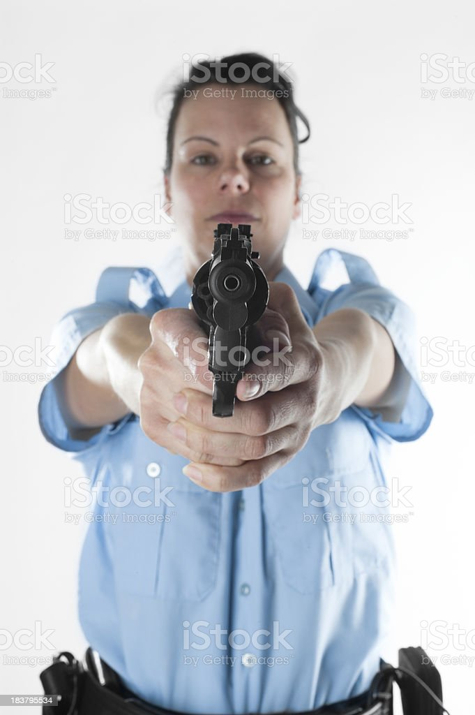 Policewoman shooting royalty-free stock photo