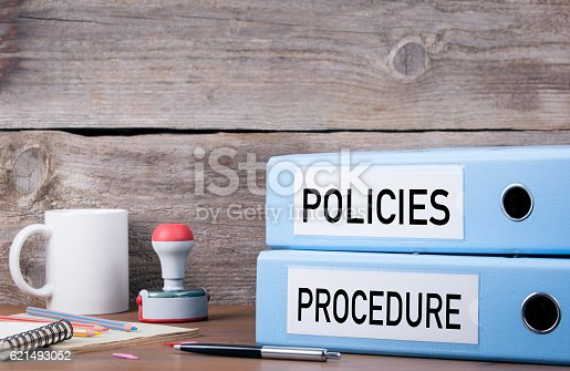 istock Policies and Procedure. Two binders on desk 621493052