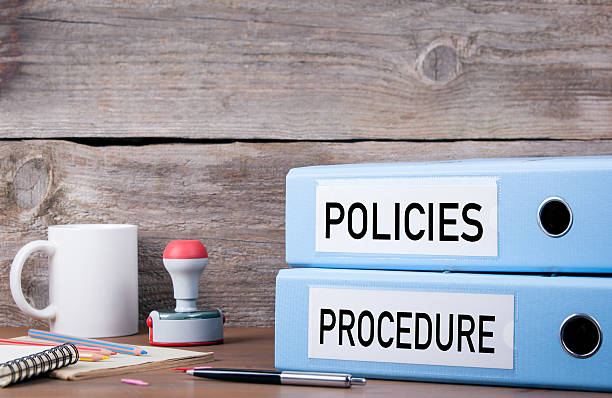 Policies and Procedure. Two binders on desk - foto stock