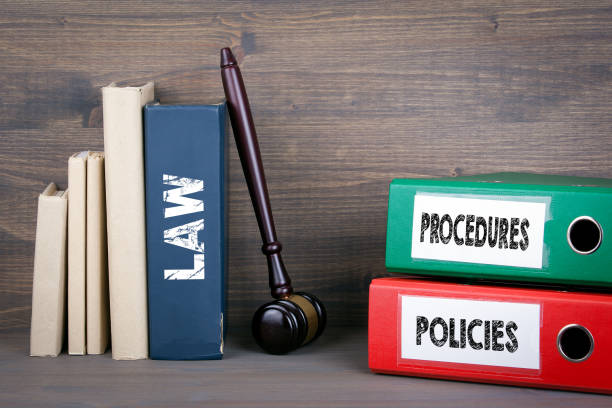 policies and procedures concept. wooden gavel and books in background - privacy policy stock photos and pictures