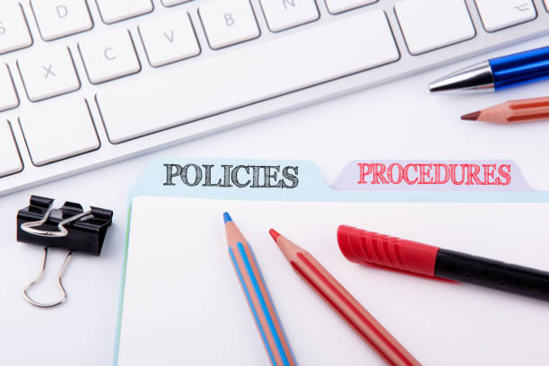 Policies and Procedures. Folder Register on a white Office Table stock photo