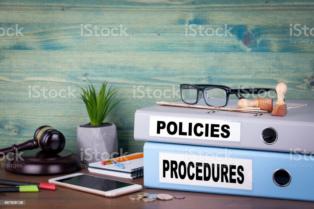 Policies and Procedures. Successful business, law and profit background stock photo