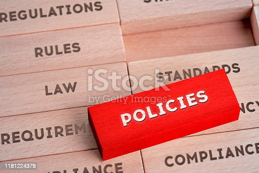 531925785 istock photo Policies Concept with Wooden Blocks in Red Color 1181224379