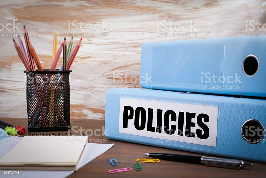 Policies, Office Binder on Wooden Desk stock photo