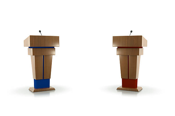 polictcal debate Two Podiums facing each other one blue one red.Isolated on white.Could be a useful image for a debate composition.This is a detailed 3d rendering. debate stock pictures, royalty-free photos & images