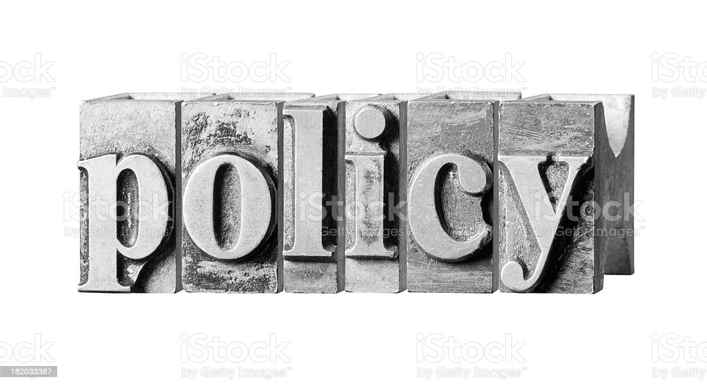 Policy  written in metal printing press letters royalty-free stock photo
