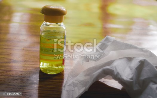 istock Polio vaccine vaccination bottle and Hand Sanitizer napkin, disinfecting products on table to prevent spread of coronavirus epidemic disease COVID - 19. 1214438797
