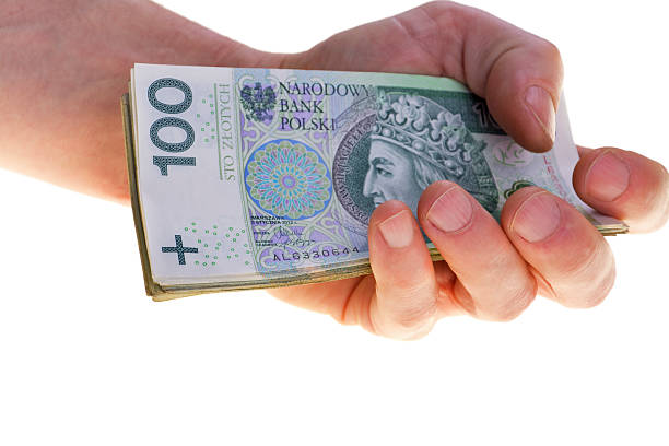 Polish currency banknotes hundred zloty stacked in hand. stock photo