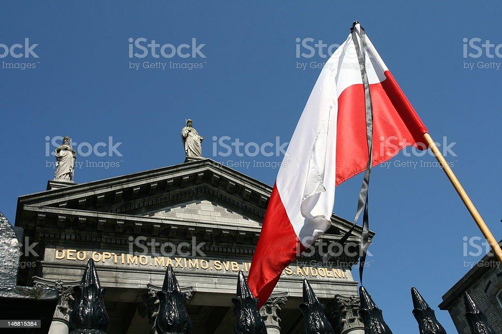 Polish Flag with the black ribbon stock photo