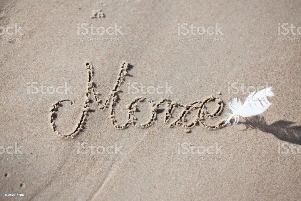 Polish inscription on the beach 'morze'. holiday, beach, inscription on the sand, stock photo